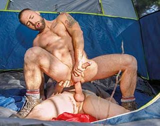 While out hiking alone on the trails, Jeremy London runs into tatted stud Derek Thibeau undressing at his campsite. He decides to sit back in the brush and watch as Derek strips completely naked and takes shower.