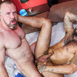 Max Sargent and Rikk York get a good feel of each other bodies before the kissing starts. While undressing Max goes down on his knees and sucks on Rikk's big dick then licks his ass.